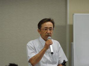 説明する鈴木正美公益事業推進委員長